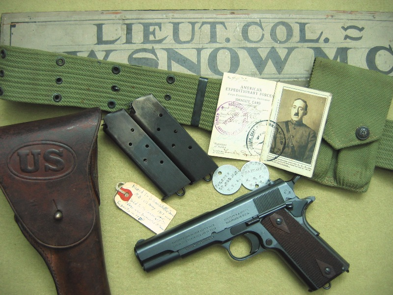 1915 Colt M1911 rig and items of decorated WWI veteran LTC Frank W. Snow who served with the British (B.E.F.) 1915, the American (A.E.F.) 1917-1918 and Post-WWI in Poland with the Red Cross